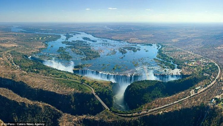 A rainbow perfectly captured at the Victoria Falls in Zambia