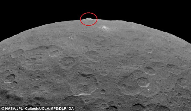 The mountain (seen here in another recent image) is peculiar, as there are a few other features like it in the surrounding region - or even the rest of the dwarf planet
