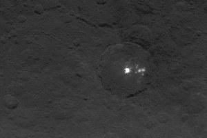 This image reveals the bright spots in greater detail. Several spots can be seen next to the largest bright area on the left, estimated to be six miles (9km) wide