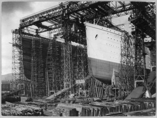 Olympic and Titanic, under construction, side by side. Belfast 1910.,