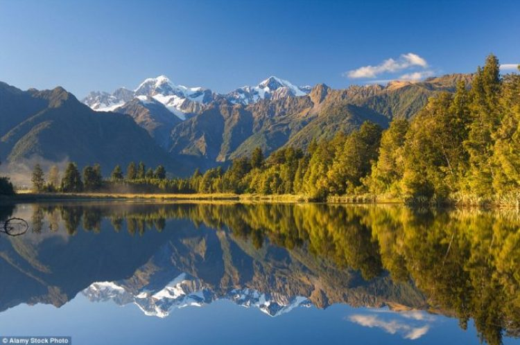 Picture perfect scenery can be seen by Lake Matheson with Mount Tasman and Mount Cook in the background