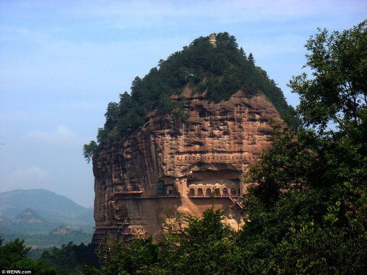 the Maijishan Grottoes, cut in the side of the hill of Majishan in Tianshui, Gansu Province, feature a stunning selection of murals and sculptures surrounded by winding walkways and spiral stairs