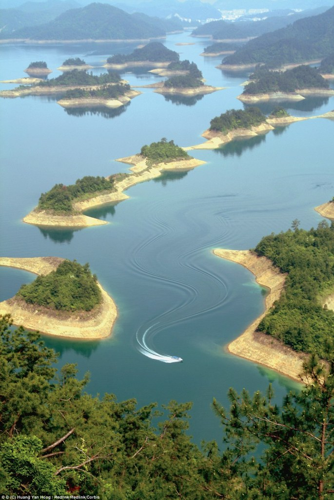 Take a boat and weave in and out of the dotted man-made islands that make up the Qiandao or Thousand Island Lake