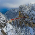 Train Piercing Through Snow-Capped Mountains of Highest Railway in Europe