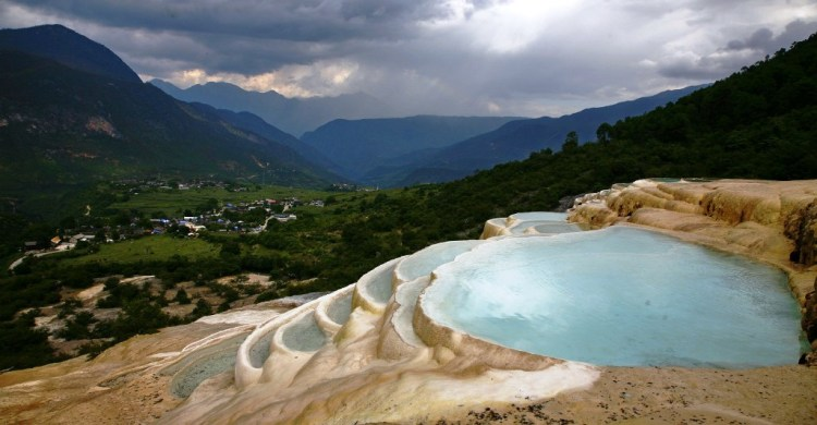 Baishuitai is a village (also known as White Water Terraces), between Lijiang and Shangri-La County in northwestern Yunnan province, China.