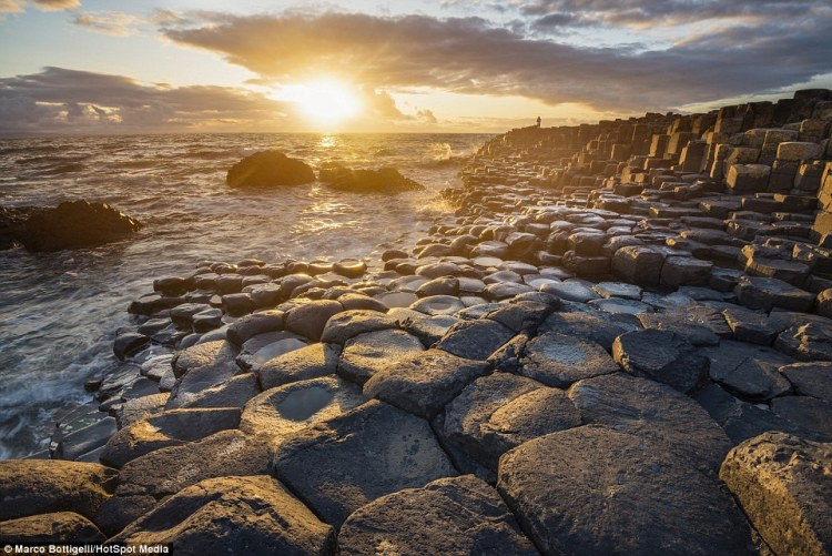 Forget sandy beaches, the pebbled and rock formations of the Giant's Causeway (above) in County Antrim, Northern Ireland are dramatic and world famous for their eerie beauty