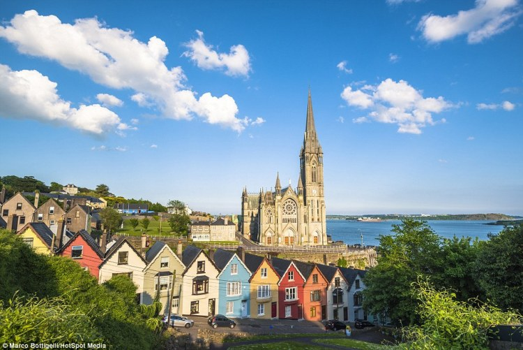 The coloured houses of Cobh (above), County Cork, Republic of Ireland, sit in a row facing perpendicular to the dramatic Irish coast