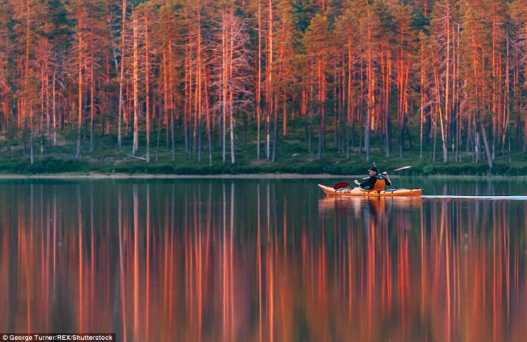 Kayaking under the midnight sun in Hossa, Finland.  To get to this spot, Turner and his friend had to paddle for over an hour into the wilderness