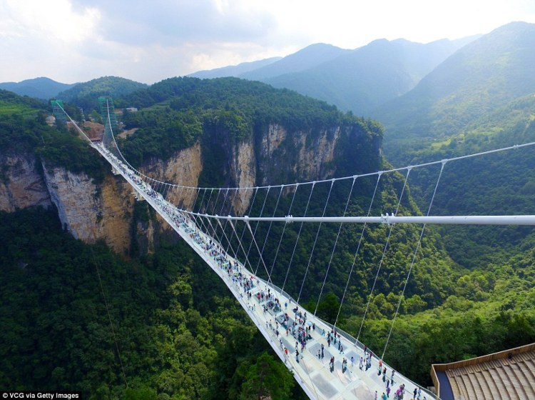 The new glass-bottomed bridge crosses two peaks in the mountains of Zhangjiajie - the same ranges that inspired the American blockbuster Avatar