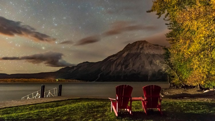 A nightscape scene at Linnet Lake area in Waterton Lakes National Park, looking east over Upper Waterton Lake and toward Vimy Pe