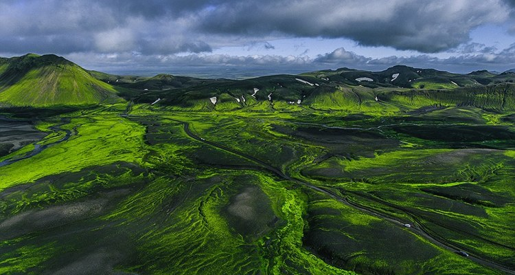 This incredible image shows the contrast of the ash-grey volcanic land against the lush green countryside