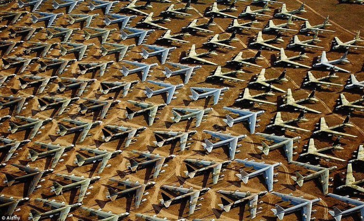 Rows upon rows of once-majestic aircraft are lined up in the baking heat of Arizona's Tucson desert, left abandoned to the elements in piles of rusting metal. Pictured here are B-52s