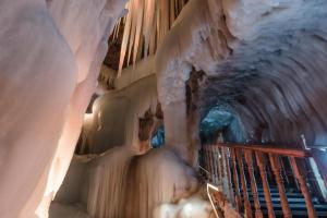 The cave is open round the year, makes the chilly winter blow into the cave and freezes the snow inside