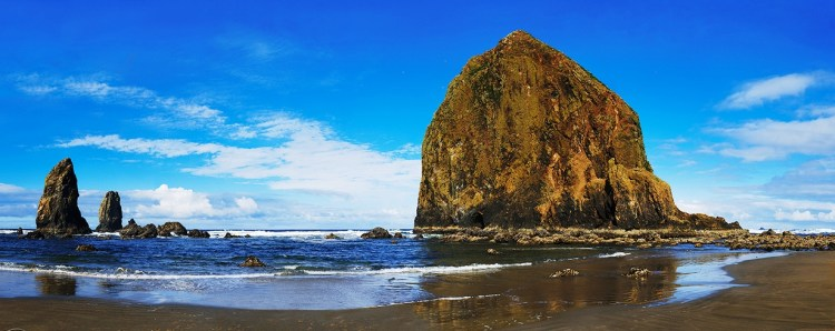 There are 6 other geographic features in Oregon named Haystack Rock, including two others along the Oregon Coast and others throughout the U.S. Haystack Rock is accompanied by several smaller rocks known as The Needles.