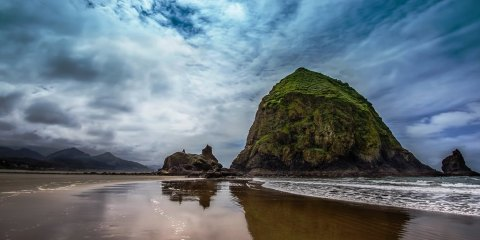 Haystack Rock is located about 1.5 miles south of downtown Cannon Beach in Clatsop County and about 80 miles west of Portland.