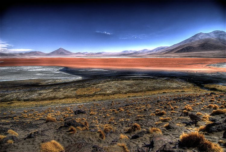 Southwest Bolivia contains some of the world's wildest and most remarkable landscapes, including the Laguna Verde, backed by the dormant 19,555ft Licancábur volcano.
