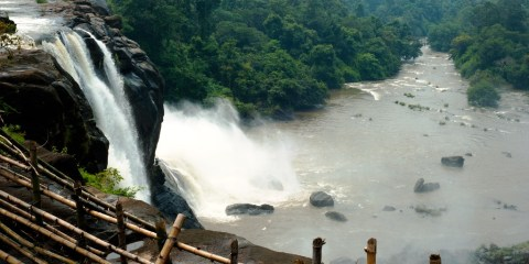 Marvel at Athirapally Falls, is one of India's biggest cascades, emerging from numerous streams flowing through a thick forest landscape.