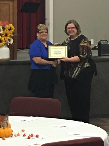 Photo of Connie Lambrecht and Nancy P accepting DSP of the Year 2017