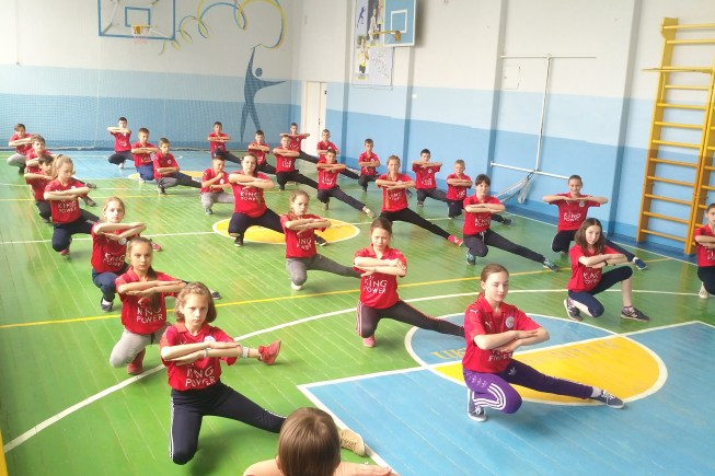 a group of children in a school gym