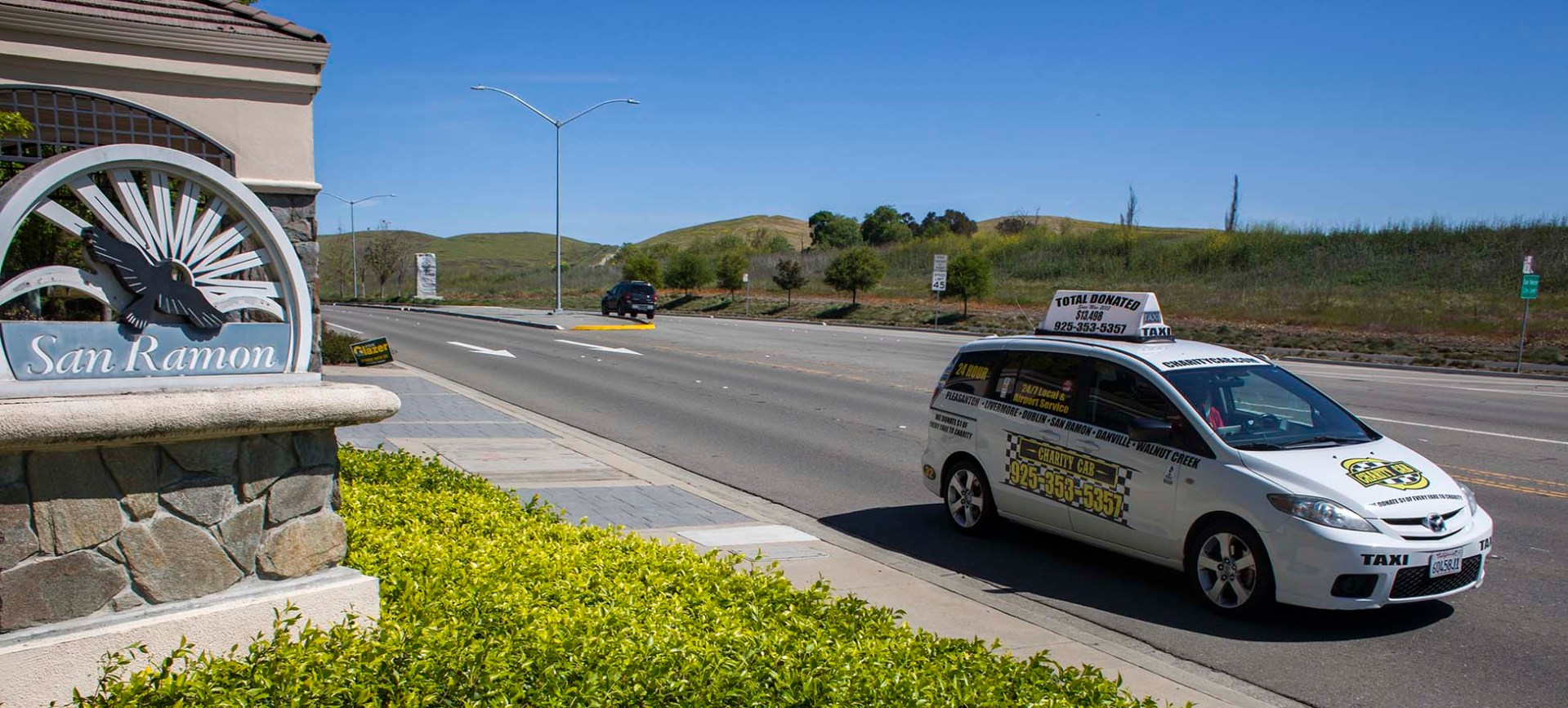 Charity Cab taxi drives by San Ramon city sign
