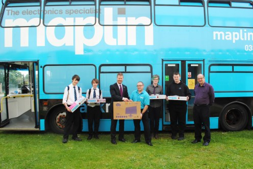 Rector Chris O'Neill accepts a generous donation of equipment from Maplin Manager Mr Trevor White