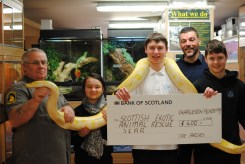 Nick accepts a cheque from our pupils...