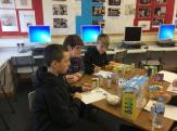 Mrs Hunter DHT working with some pupils measuring sugar levels