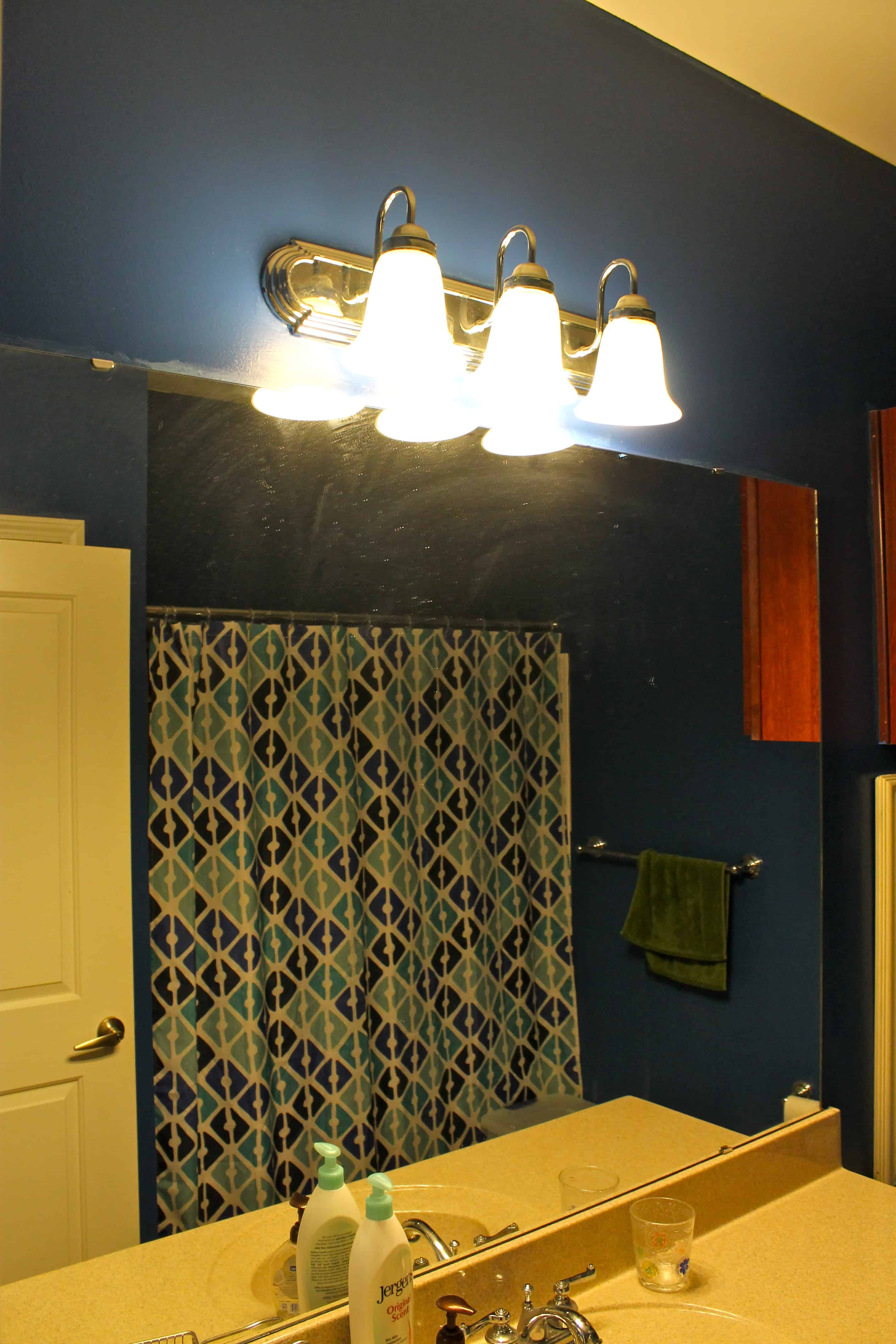 Upgrading a Standard Bathroom Light Fixture with a Dip of Paint