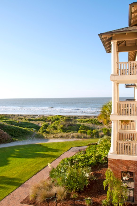 FROM THE OUTSIDE, The Sanctuary at Kiawah Island Golf Resort resembles an oversized seaside mansion, the sort of hushed estate that would fit right in with Newport's storied turn-of-the-19th-century summer residences. Thanks to a gentle rise in the land on which the hotel sits, a sweeping, unobstructed ocean view greets everyone who walks through the front door.