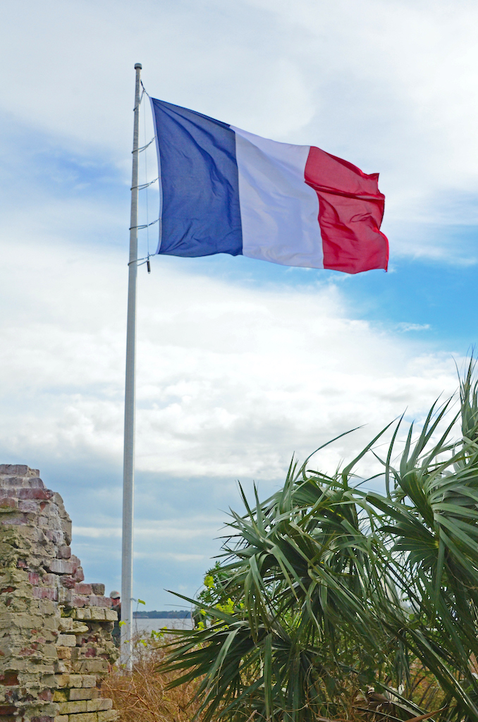 The French Tri-Color flag flying over Castle Pinckney in Charleston Harbor