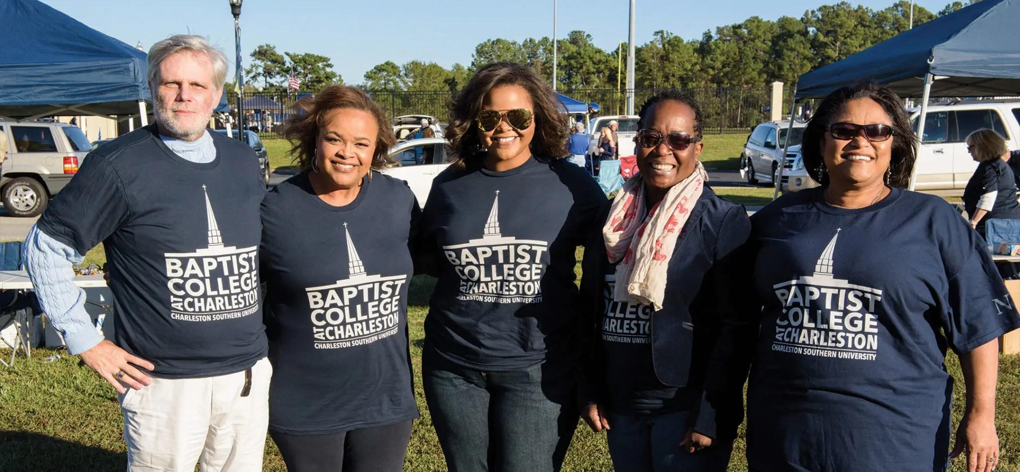 CSU alumni wearing Baptist College t-shirts.