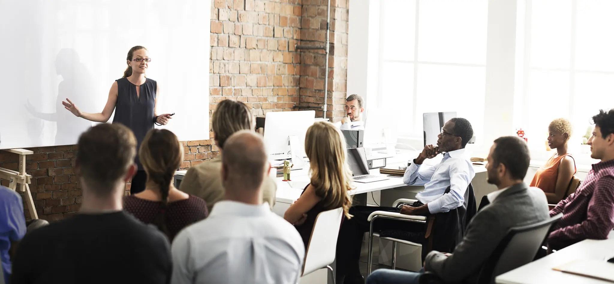 Business team listening to an entrepreneur speak.
