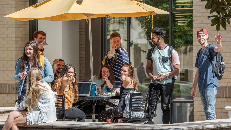 Students sitting outside on CSU's campus enjoying a sunny day in Charleston, South Carolina