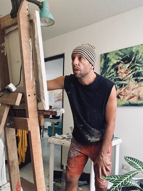 Charley Jones painting in studio