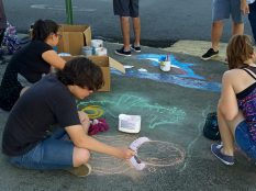 Youth painting environmental message