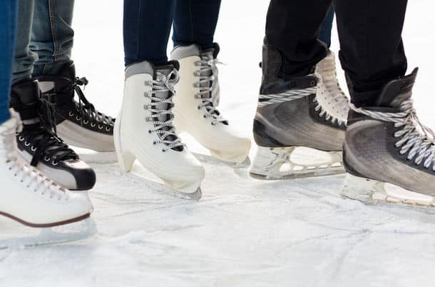 People Winter Sport And Leisure Concept Close Up Of Legs In Skates On Skating Rink