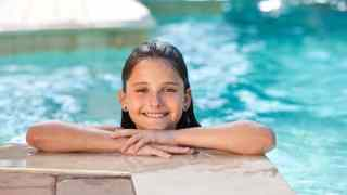 Happy Pretty Girl Child Smiling In Swimming Pool