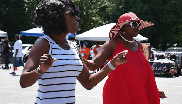two women dancing at east side music festival in charlotte