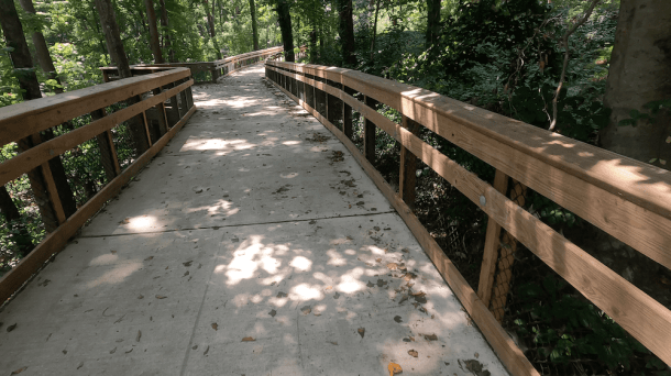 bridge on toby creek greenway in charlotte through wooded area