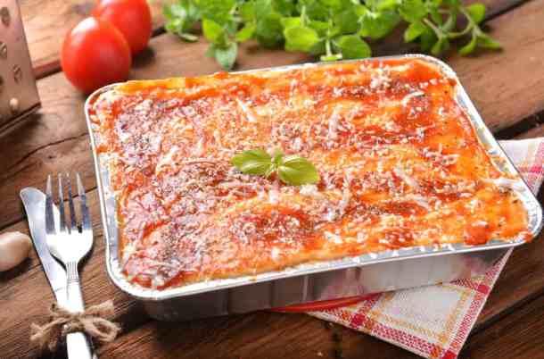 homemade lasagna in a foil pan