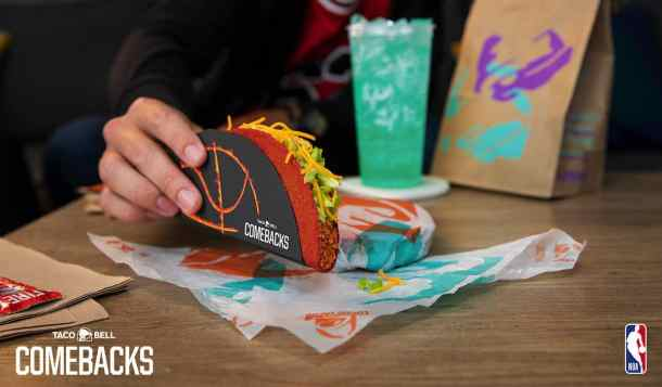 Hand holding Flamin' Hot Doritos Locos Taco