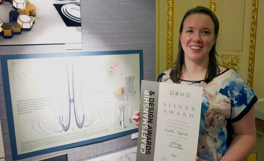 Charlotte with her winning design at Goldsmiths Hall