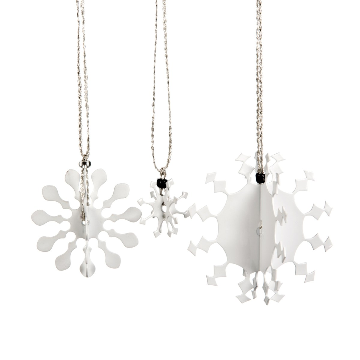 Three 3D metal snowflakes coated in white enamel paint for hanging on the Christmas tree.