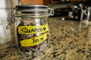 Swear Jar - Image of Glass Jar Filled With Coins After Using Swear Words
