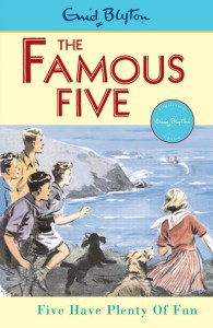 Vintage Cover of Famous Five Novel shows kids and dog at the beach