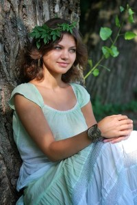 girl sitting under tree looking natural