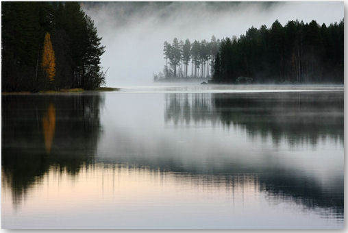 fog lifts over the water - © *Sparvoga