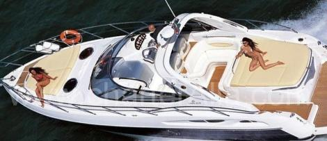Sunbathing on board of Cranchi 39 Endurance fast boat with the captain in Ibiza