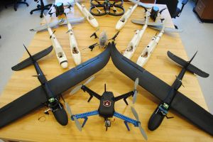 A collection of the fixed-wing and multi-rotor (quadcopter) UAVs in our fleet.