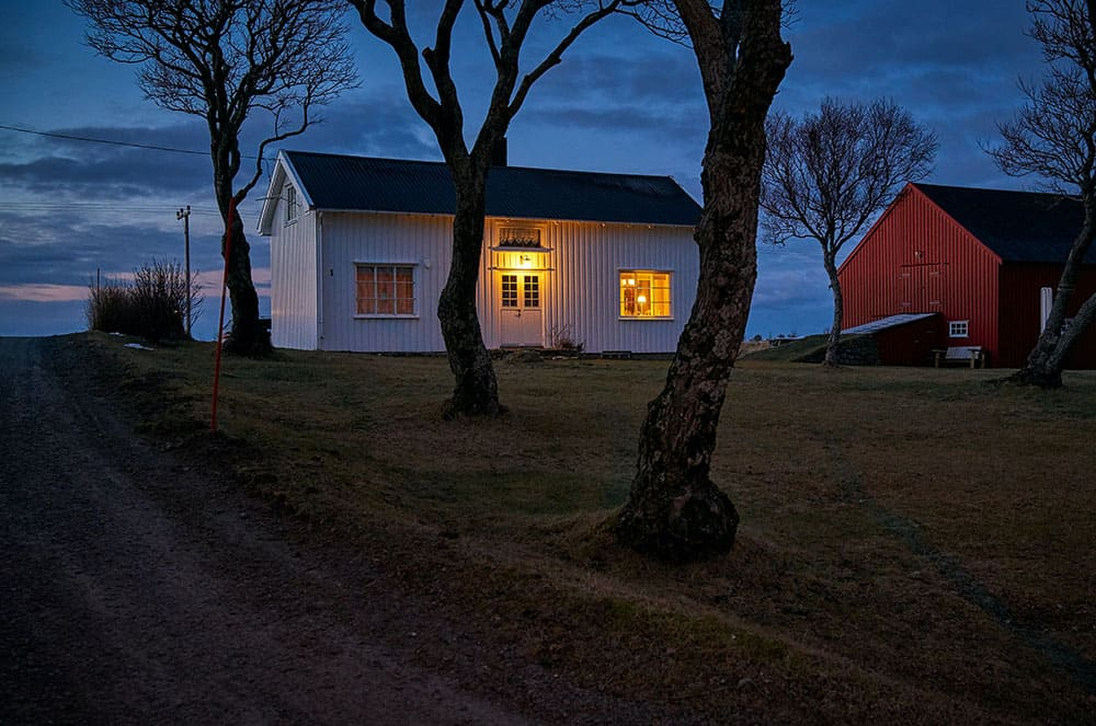 Barn with outdoor security light on at night, which is contributing to light pollution